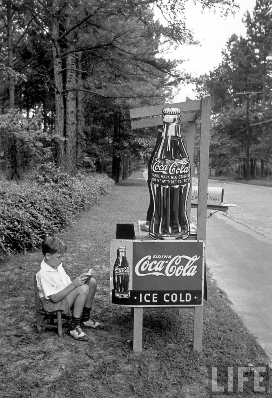 Boy selling Coca Cola from roadside stand. Atlanta, 1936. ByAlfred Eisenstaedt