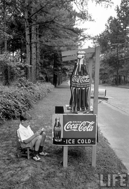 Boy selling Coca Cola from roadside stand. Atlanta, 1936.