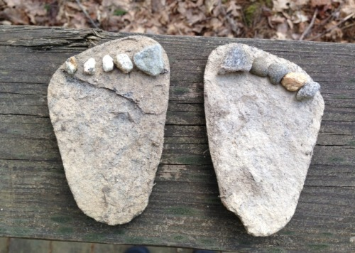"Found this make-shift ""rock feet""  sculpture on the wooden trails behind our corporate HQ in Freeport.  A rock naturally split in half and a clever hiker turned it into art.  #LunchTimeProject"