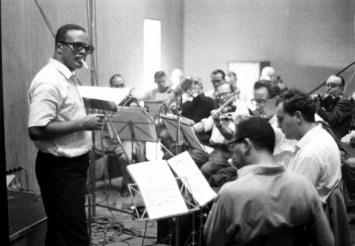 Quincy Jones at work at a Sarah Vaughan recording session in Copenhagen, Denmark in 1963. Photo: Lebrecht Music & Arts/Corbis.