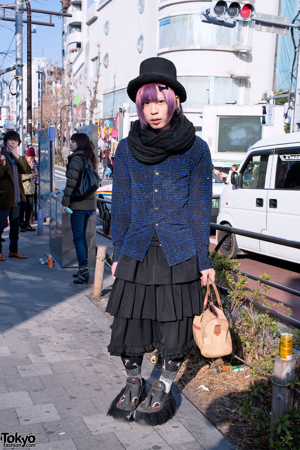 Harajuku guy w/ purple hair, labret piercing & Swear Alternative shoes that have fur, eyeballs, and horns.