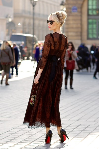 fuckyeahstreetstyle:  Ulyana Sergeenko wearing a dress that she designed, D&G bag and Christian Louboutin shoes