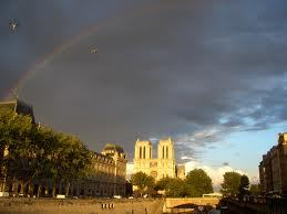 Notre Dame with a rainbow over it