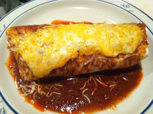"Chile Colorado Burrito (crockpot recipe, but stovetop instructions included) Easiest recipe I've ever made.  Guys I'm DYING over how easy and incredibly delicious this is!!! I wasn't expecting much because canned enchilada sauce can be ""eh,"" but it was great!  Recipe taken from Food Pusher Next time I will try Chile Verde Burritos :) Difficulty: * Ingredients (makes 3 burritos. Double for more): - 1 lb stew meat - 1 14 oz can Old El Paso red enchilada sauce (I love this brand… others make me gag.  I do not guarantee the outcome of your burritos if you use a different brand ;) )- 2 beef bouillon cubes (the store was out so I just used my tomato-chicken ones and it was great!) - 1/2 can refried beans - burrito size flour tortillas - shredded cheese Recipe: 1. Dump beef, enchilada sauce, and bouillon cubes into crock pot.  Cook on high 3.5 hours.  (OR low 7-8 hours OR bring to a boil on stove and then put on low and simmer for 1.5-2 hours) 2. When beef is done, heat refried beans in microwave. 3. Put beans and meat and a little cheese in tortilla (use slotted spoon so you dont scoop much sauce), roll into a burrito. Put burrito on oven safe plate. 4. Pour sauce from crockpot over the burrito and sprinkle with cheese. 5. Set oven to broil on high and put burrito in for 2 mins 6. Hot plate! enjoy! Seriously Eatsy: The Not-Your-Average-Cooking-Blog Blog"