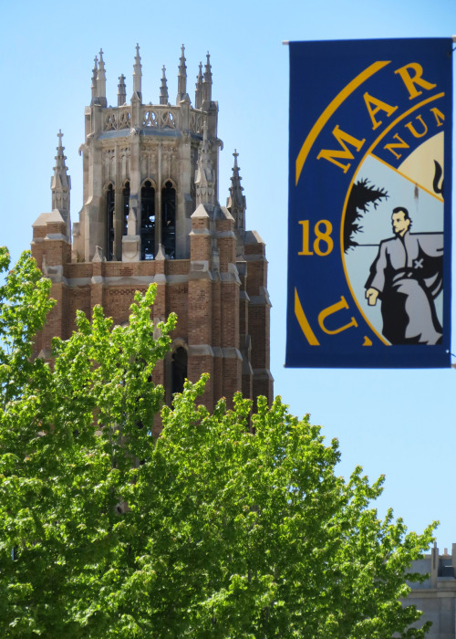 postmarq:  The tower of Marquette Hall at Marquette University.  Nice photobomb, Father Marquette.