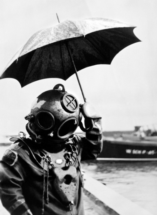 Deep-sea-diver with an umbrella, from Retronaut.