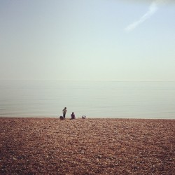 Barely a cloud in the sky or a ripple on the water (at Hove Lawns)
