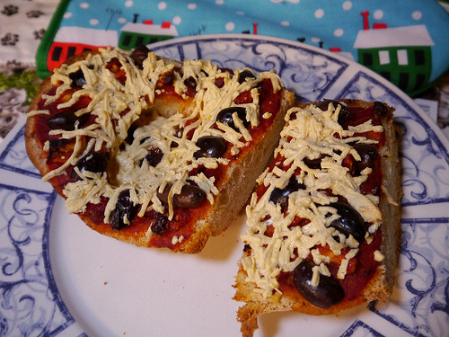 French bread pizza! There was a huge air bubble in the middle of the loaf, which ended up being a pretty convenient receptacle for extra Daiya cheese. American ingenuity, yay!