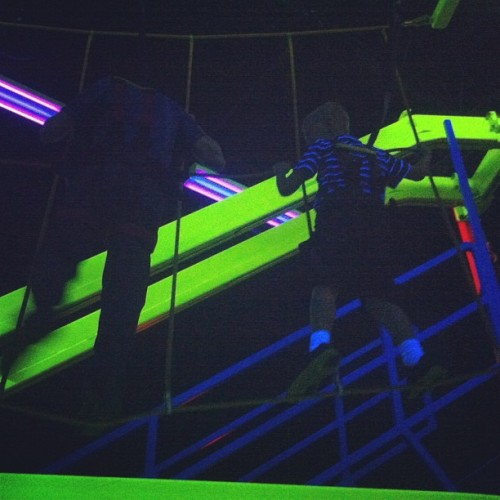 Climbing the ropes with a black-light.  #blacklight #climbing #ropes #fun