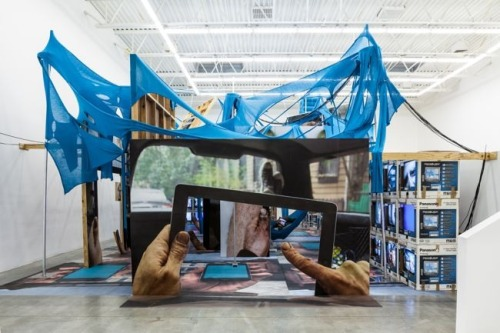 Jon Kessler, The Web:   The Web is an immersive installation that addresses the significance of the Internet and mobile devices in our lives while simultaneously examining the role of the viewer.    Building art experiences around today's tech behavior is getting more common.  It's worthy of a mockery since humans are communicating more than ever through status posts and  creativity rather than face to face interaction.  This is in addition to all the do it yourself creativity, popularized by innovative Apple products.