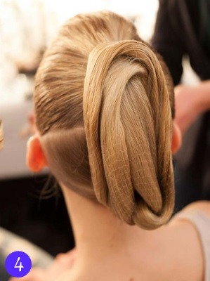 hairproblems-inspiration:  DIY The Temperley Bun Separate the hair horizontally into two pony tails with a separating comb. Then for the 'roping', simply twist the top pony around and around on itself. Then wrapped this twist around the bottom pony and back around the top in a figure of eight and use two kirby grips to secure it. Then take the lower pony and wrap it around the higher one and back down and clip in place. For final touches use Hairspray to smooth down the hair all over and to make it look slicker, and if you want put a fishnet over the huge bun you've created.