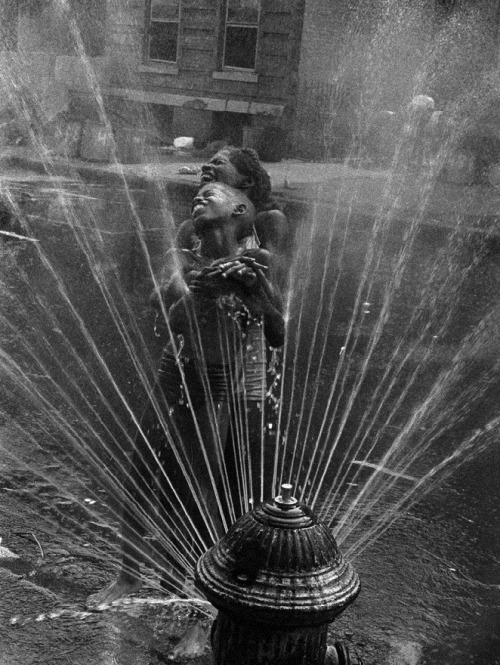losed:  USA, 1963, New York City, Harlem, the fire hydrants are opended during the summer by Leonard Freed