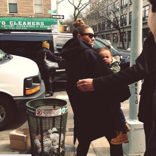surisburnbook:  Blue Ivy Carter was spotted in Brooklyn (haha) this weekend with her mom, and oh my gosh look how tall she is! Look at her workboots. Look at her ability to exist that close to a public trash can without freaking out. She's not fooling me into thinking she's tougher than me, though. Okay, fine, she might be tougher than me.  Loving the poofy pigtails, Blue!