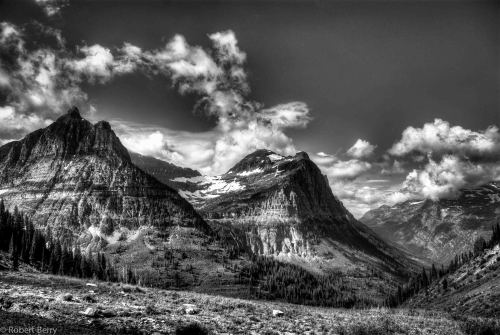 """Going To The Sun Road""   For your daily dose of HDR this image on the Going to the sun road in Glacier National Park Montana.  Breathtaking views, cascading streams a photographers dream.. Ansel Adams photographed much of Glacier so I am always in awe of his work. One exposure HDR Processed in Photomatix Pro, converted in Silver Efexs Pro and Lightroom 4. Nikon D80 with Nikkor 50MM Lens Visit my Hipstamatic blog at http://www.hipstamaticpics.com"
