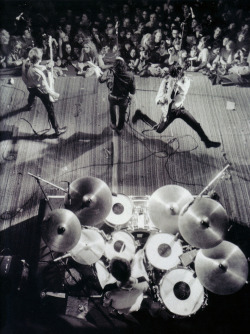 rocknrollhighskool:  The Clash on stage at the Berkeley Community Center, CA on Feb 7th, 1979   Stage front left to right we have Paul Simonon, Joe Strummer and Mick Jones with Topper on the drums  Photo by Roger Ressmeyer