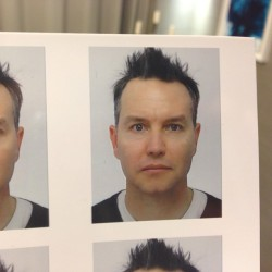 Passport photo. Remove eyewear. Look directly at the camera. Do not smile. Affect a stare of rage and instability.