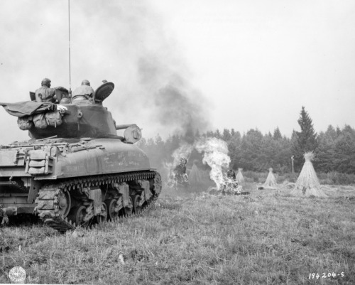 An M4 Sherman showing off its flamethrower, 1944
