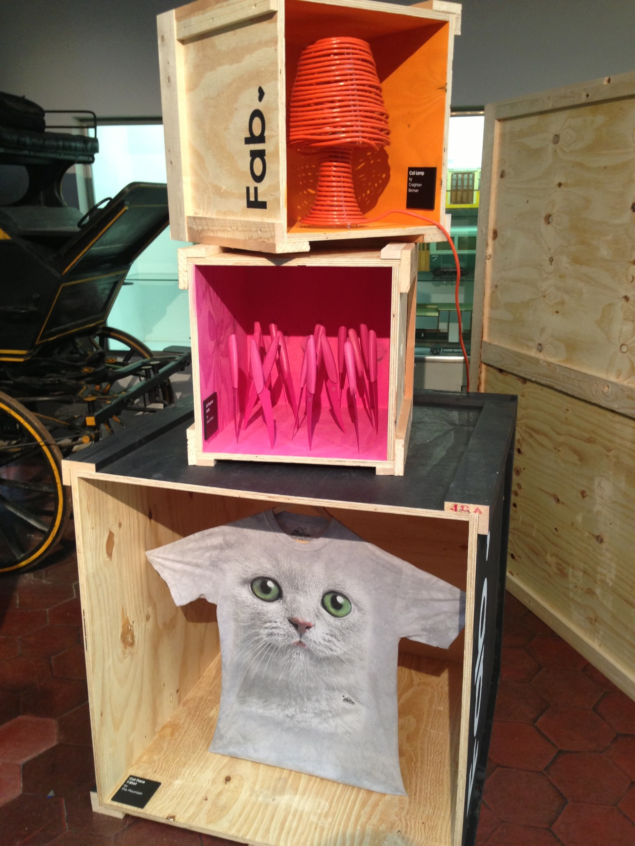 Fab at Milan Design Week: Coil lamp, pink knives, cat t-shirt. Somehow makes sense. via my homie Tim Liles