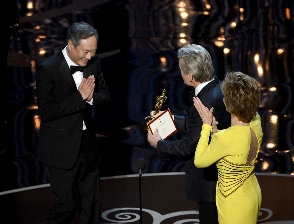 nparts:  Ang Lee accepts the Best Director award for Life of Pi from Michael Douglas and Jane Fonda. (Photo by Kevin Winter/Getty Images) More: http://natpo.st/XzvSrs