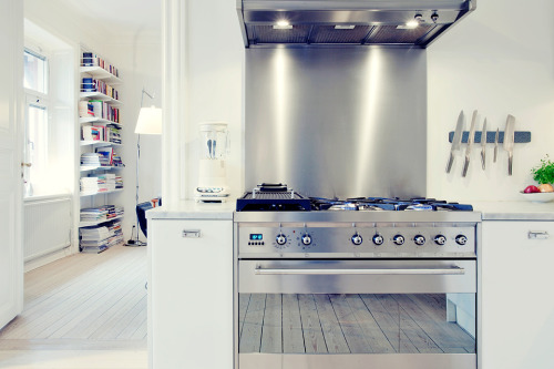 Source: Fantastic Frank Personally I love stainless steel kitchens and appliances. They have an industrial yet familiar and user friendly appeal to them. To make it less harsh pair the steel with natural woods - otherwise keep it light and bright like above for a more contemporary feel.