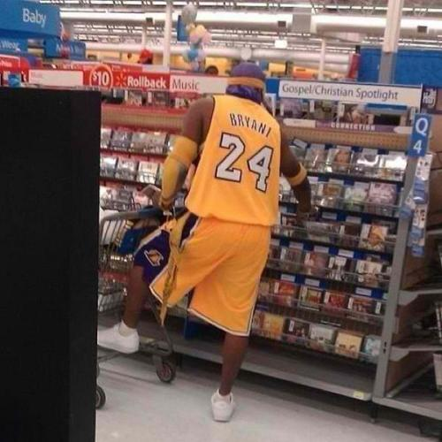 nosebleedhooligans:  sexbooksandvacations:  kobe bryant at walmart  Kobe's such a cheap shit eyeing $10 rollback CDs