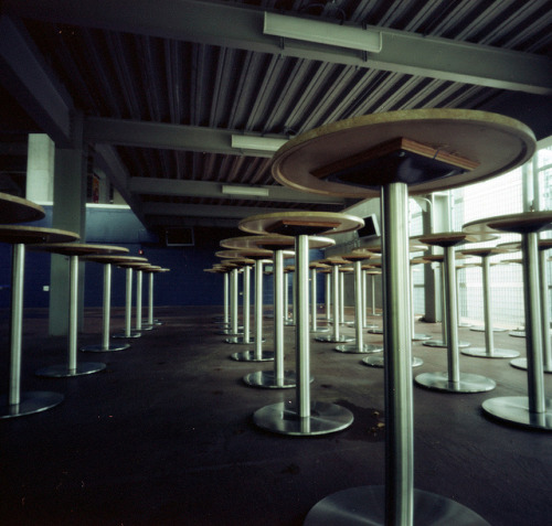 Pinhole: Waiting on Flickr.Standing tables at LP Field, home of the Tennessee Titans. Part of my Worldwide Pinhole Day roll shot April 28. Zero Image 6x9, f/235, Kodak Portra 100T, 4 minutes