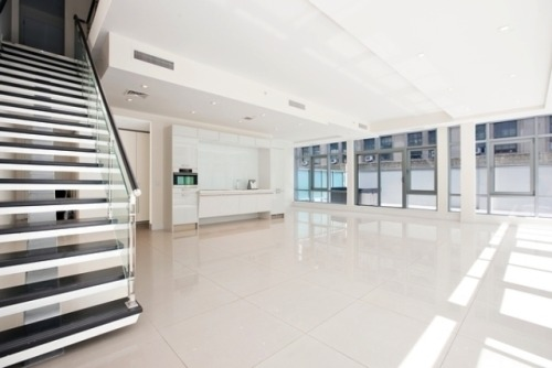 Take a look at the blank white canvas of this NYC Financial District Duplex Penthouse Loft's lower floor
