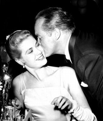 Grace Kelly gets a congratulatory kiss from Oscar host Bob Hope, 1955.