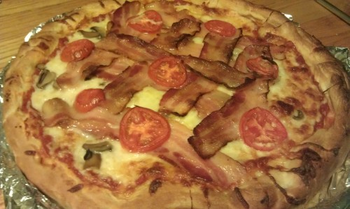 Pizza #30 Bacon, Mushroom,and Plum Tomato This pie was somewhat impromptu and for the most part used what we had that went well together. The bacon which goes with everything, was high quality Boar's Head Bacon. Going cheap on bacon increases the fat content, which results in more grease being released in the oven and a slightly sloppier pizza. So higher quality bacon is worth it, splurge on the bacon on your own pizza. The mushrooms are another story. On a pizza, use mushrooms from either end of the spectrum. High quality fresh mushrooms crisp and bake up nice, retaining a lot of their natural woodsy, earthy flavor. Canned, generic mushrooms create great texture (when drained and pressed dry between paper towels to remove as much moisture as possible) and a commonly enjoyed mushroom flavor. Middle of the road mushrooms, I find, become mediocre in both taste and texture. Plum tomatoes evolved for the oven, they retain such sweet garden flavor and great texture. Plus they add some much needed color to a pizza. For a last minute pizza idea, this one came out amazing. Grades: Me: A Sam: A-