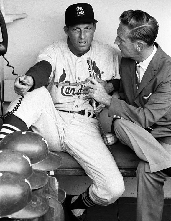 The St. Louis Cardinals' Stan Musial talks to Los Angeles Dodgers announcer Vin Scully before a game at Dodger Stadium in 1963. (Neil Leifer/SI)