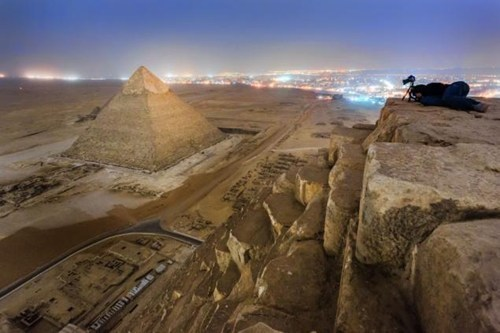 thedailywhat:  A New Perspective of the Day: From the Top of the Egyptian Pyramid A group of Russians took this photograph after illegally climbing the Great Pyramid of Giza during their trip to Egypt last week. Climbing the pyramid is strictly prohibited under the Egyptian law and may result in a punishment of one to three years in Egyptian prison.