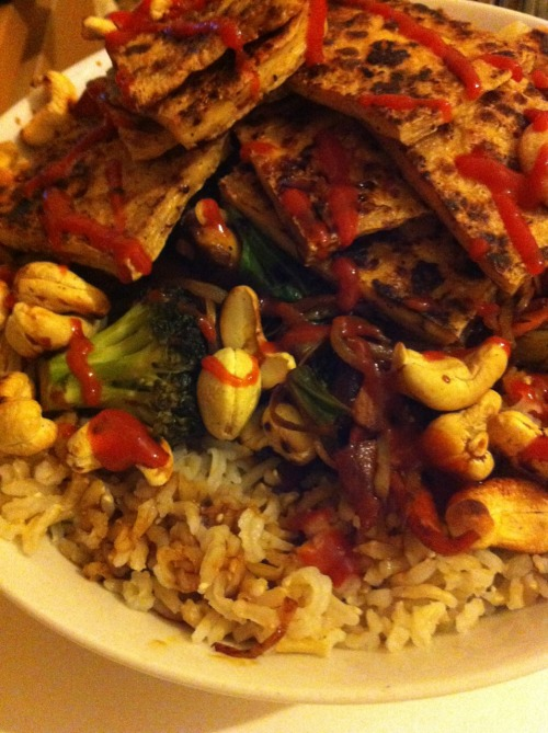 Brown basmati rice, fried tofu, stir fried veggies, toasted cashews, sriracha (Home meal)