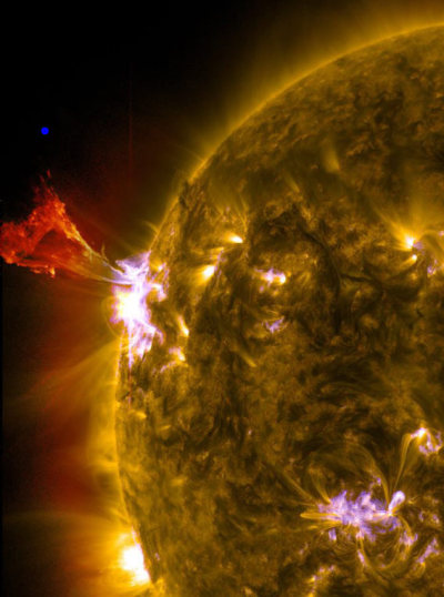 Massive Solar Flare That Dwarfs The Size Of Our Planet.