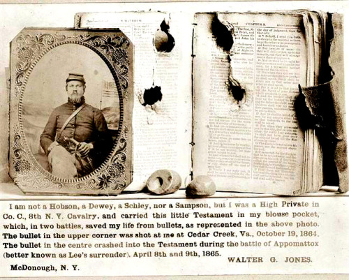 Civil War Bible with Bullet Holes Walter G. Jones, Private, 8th New York Cavalry, Co. C., U.S.A., half-length, facing front and his New Testament with bullet holes, and the two bullets which lodged in the book. It was taken between 1861 and 1865.