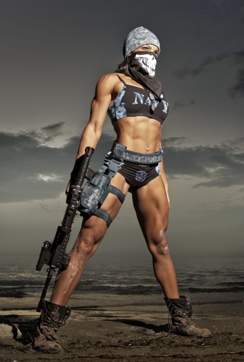 workoutfitnessmotivation:  Nice. Fit girl with gun from We Heart It.