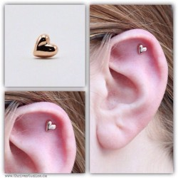 thrivestudios:  A fresh helix piercing with a beautiful rose gold puffy heart from #BVLA  #BVLA #bodyvisionlosangeles #gold #rosegold #thrivestudios #justapiercer #mybodymod #piercing #bodypiercing #safepiercing #associationofprofessionalpiercers