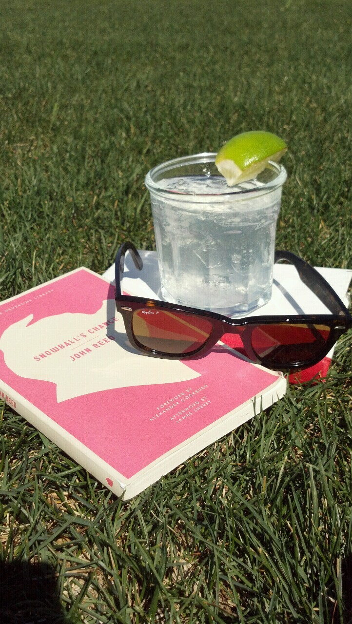 Some afternoons just call for a book you can't put down and a cocktail.