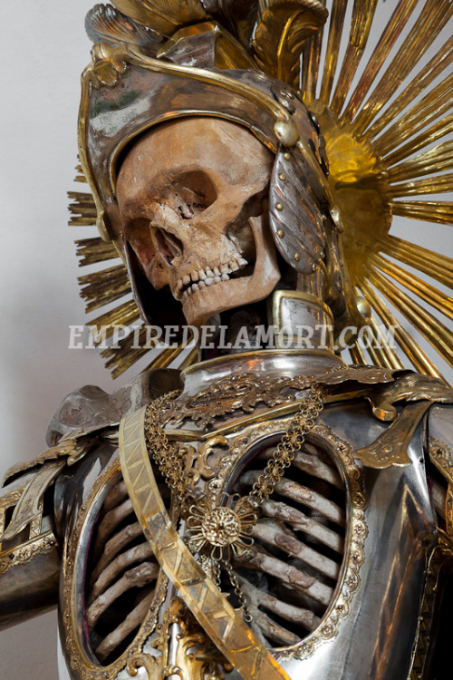 SKELETON OF THE WEEK, MARCH 18: ST. PANCRATIUS FROM WIL, SWITZERLAND Last week's skeleton, St. Maximus in Bürglen, is one of two armored skeletons still extant in Switzerland. The other is his esteemed colleague, St. Pancratius, who arrived in the city of Wil in the 1670s, and has been gracing the local Church of St. Nicholas ever since. Taken from the Roman Catacombs, his bones were sent to St. Gallen, where they were articulated by a team of nuns, who dressed in him Roman-style costuming. His current armor, then, is not original with his display. Rather, it dates to a century later, and was commissioned on the skeleton's centennial anniversary in Wil in order to honor and thank him for a century of service.  Via Empire de la Mort