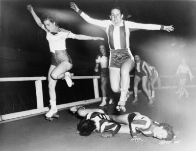 smartchickscommune:  Two women's league roller derby skaters leap over two who have fallen / World-Telegram photo by Al Aumuller. (via)  Love some roller derby girls!