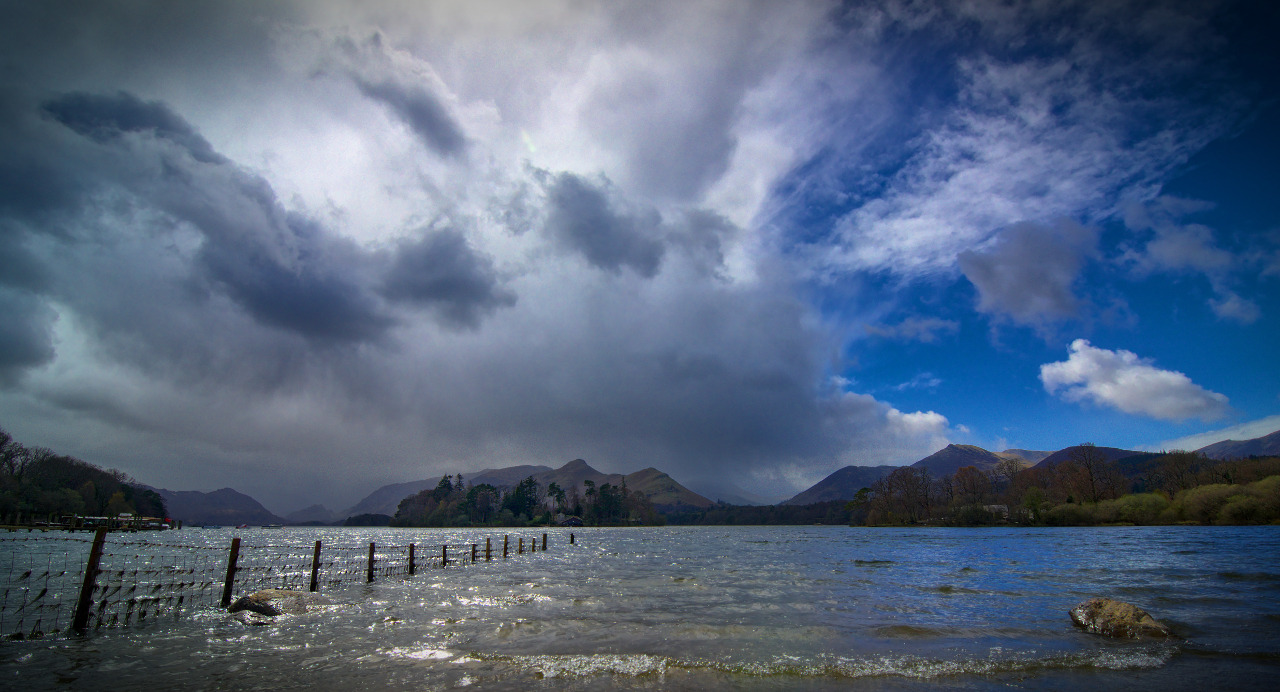 Today's Photo Wrestle of Elements. A storm stampedes towards the Derwentwater fells, who stand resolute and braced for another battle… This was shot on the first evening of our Keswick break, right on the Northern shore of Derwentwater looking towards the distant fells. It wasn't exactly the sunset we were looking for, but still an awesome sight nevertheless. =) You should order a beautiful print of this photo right here.