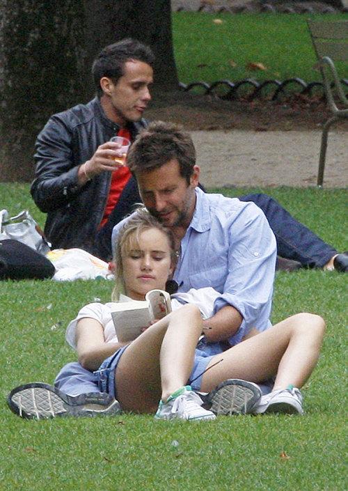 Bradley Cooper, 38, cradles 21-year-old girlfriend Suki Waterhouse, reads 'Lolita' during Parisian parkouting  disgustedbillcosby.gif