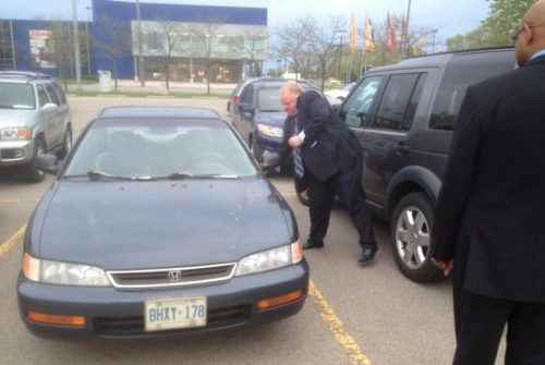 """Minutes after Mayor Rob Ford arrived at a contentious community council meeting on Tuesday evening, he bolted out of his seat, sprinted up an aisle, and left the building — to wander around the parking lot and slap ""Rob Ford Mayor"" fridge magnets on the doors of cars.  When a reporter told Ford that some people might find his behaviour strange, he retorted that some people find the reporter strange. Magnets in hand, he made no further comment. …The mayor slowed down only twice — once to calmly address the reporters who followed him, once to shout urgently to aide David Price for more magnets, his arms outstretched. …  Price [Ford's Director of Operations] scoffed at the suggestion that Ford should be attending the meeting-in-progress rather than circling the parking lot.  'He can do whatever he wants. Putting magnets on a community event — what do you expect him to be, up on stage?' Price said.""— ""Toronto Mayor Rob Ford bolts from meeting to put fridge magnets on cars."""