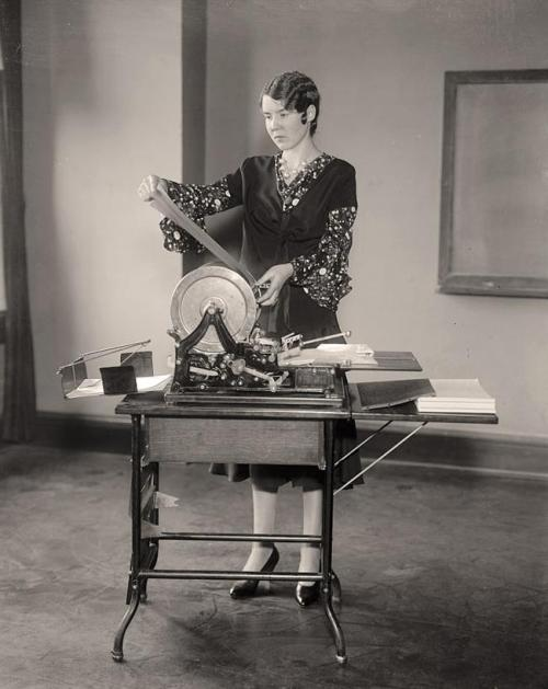 Woman using mimeograph machine at Strayer's Business College