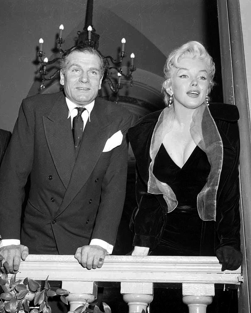 "Marilyn Monroe and Laurence Olivier at a press conference to announce their production of  ""The Prince and the Showgirl"", 1956"