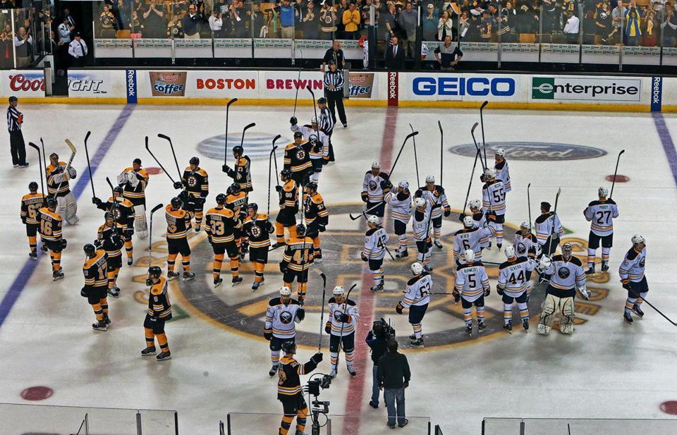 Boston Strong. After the April 17th Boston Bruins hockey game, which the Sabres won in a shootout, both teams took to center ice to salute the fans. (Jim Davis via The Boston Globe)