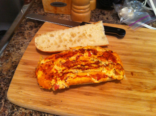 Pizza frittata. Eggs, milk, pizza sauce, mozarella cheese, onions, garlic, basil, oregano, and pepperoni.