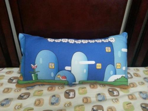 Look! Jen Harrold made this cool pillow from some of the Super Mario inspired fabric I designed! According to her, it only takes a fat quarter of fabric to add a little personality to your naps. You can read all about it and her other cool craft projects on her blog! Thanks, Jen! You can get the fabric here: http://www.spoonflower.com/fabric/322085  Or visit my whole fabric shop for more video game fabric, as well as some other random things! http://www.spoonflower.com/profiles/jaana