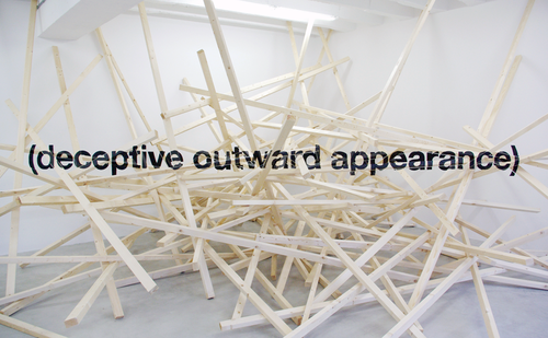 "twloha:  ""Deceptive Outward Appearance,"" an art piece made with wood and paint, was created by Ole Martin Lund Bo. It calls to mind our own deceptive outward appearances—the masks we wear, the secrets we keep—and the true self that is worth discovering and revealing."
