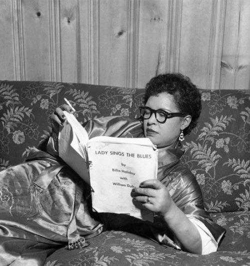 theniftyfifties:  Billie Holiday reading a manuscript of her autobiography, 'Lady Sings the Blues', 1956.