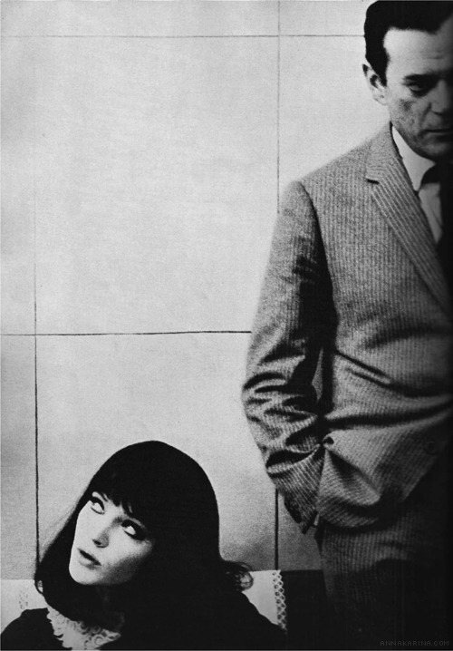 anna—karina:  Anna Karina and Eddie Constantine on the set of Alphaville. Shot by David Bailey for the September 1, 1965 edition of Vogue UK.